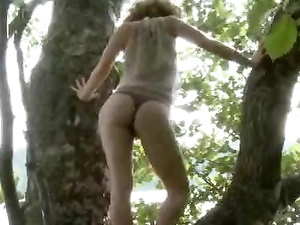 Tree Climbing Redhead Masturbates In The Forest